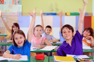 Eager children in class