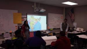 Giving an after school presentation about India with another Indian teacher in Kansas City to a class of ELL and general education student at a Culture Club.